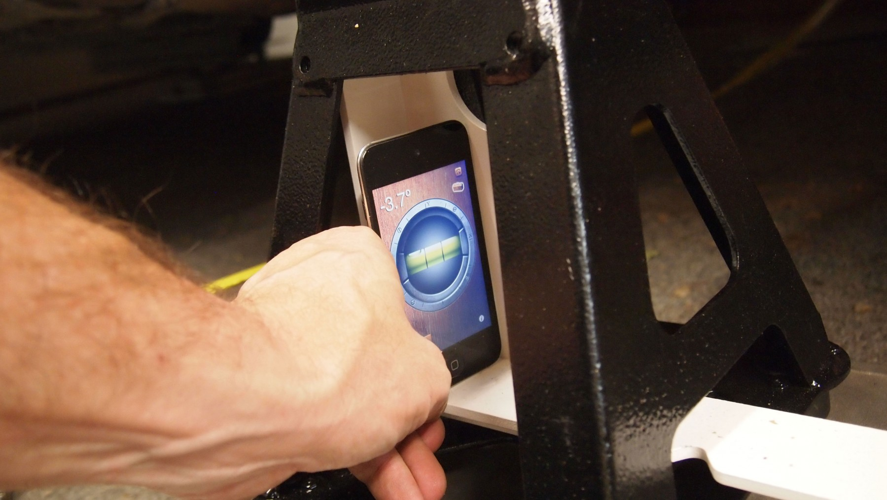 Camber can be measured with a dedicated gauge or via smartphone app.